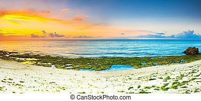 Sunrise panorama - Sunrise over the sea. Stone on the...