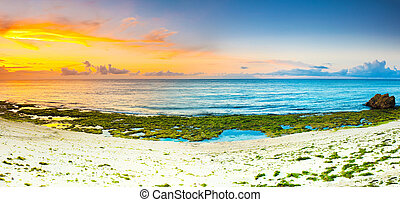Sunrise panorama - Sunrise over the sea. Stone on the ...