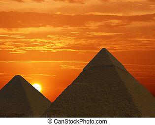 Sunrise Pyramids - Pyramids in Egypt at sunrise.