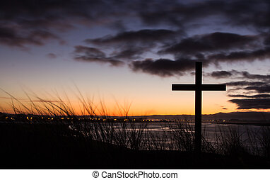 Sunrise Salvation Cross - Cross on a hill over looking a...