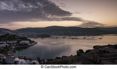 Sunrise scenery in Bodrum with boats anchored in the bay. Time lapse, 4k