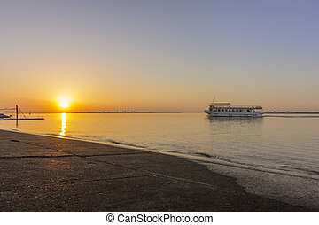 Sunrise seascape view of Olhao dockyard, waterfront to Ria...