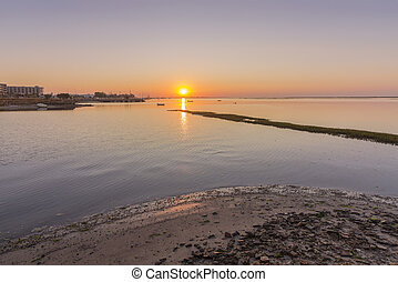 Sunrise seascape view of Olhao salt marsh Inlet, waterfront...