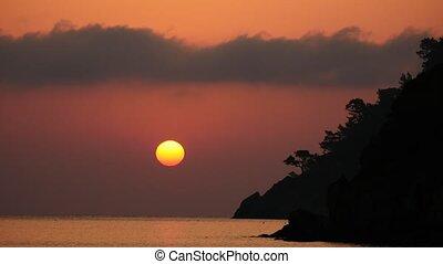 Sunrise silhouette above sea Time Lapse