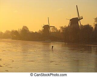 Sunrise, skater & windmills - Flamboyant sunrise with...