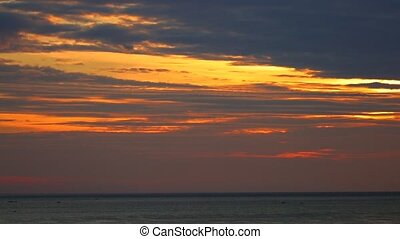South china sea tropical sunrise orange sky scene with fishing boats, ocean waves, orange red cloudscape sky, central Vietnam. Panning panoramic scenery.