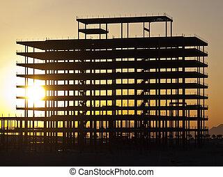 Sunrise Steel - Sunrise glowing through steel girder...