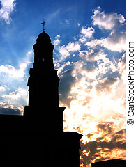 Sunrise Steeple - Silhouette of a church steeple with orange...