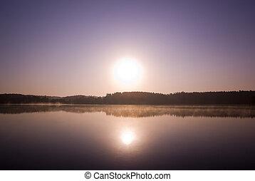 Sunrise over misty lake. Mazury, Poland. aRGB.