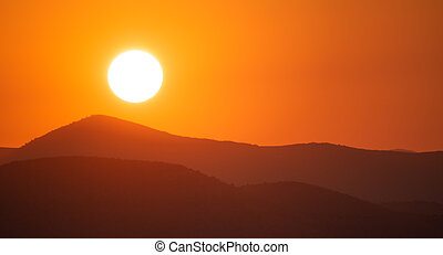 Sunrise, sunset over mountains silhouette. Colorful sky background, space, panoramic view.