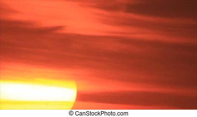 Sunrise through light clouds