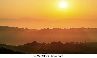 Sunrise time lapse over hills and mountains - Sunrise time ...