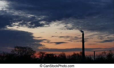 Sunrise Time Lapse Sky and moving clouds Power Plant pipe with smoke Latvia