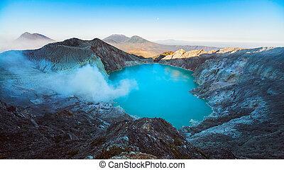 Sunrise view of Kawah Ijen volcano sulphur acidic lake -...