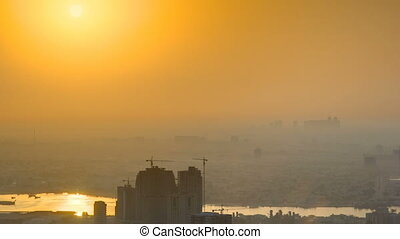 Sunrise with Cityscape of Ajman from rooftop timelapse....