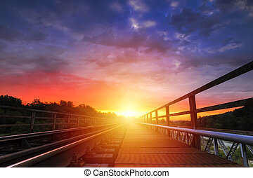 Sunrise with spectacular sky over the railroad
