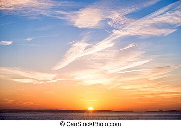 Sunrise with Sun, Blue Sky, Clouds and Sea
