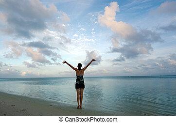 Sunrise yoga on Aitutaki Lagoon Cook Islands