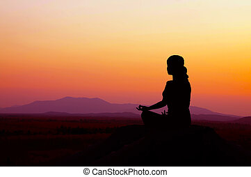 Sunrise Yoga - Silhouette of a beautiful Yoga woman in the...