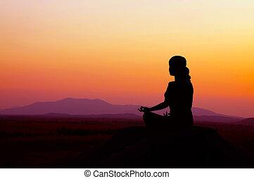 Sunrise Yoga - Silhouette of a beautiful Yoga woman in the...