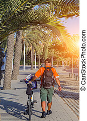 sunrise young man riding bicycle, travel spring