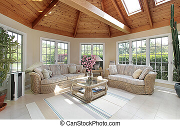 Sunroom with wood beams in luxury suburban home