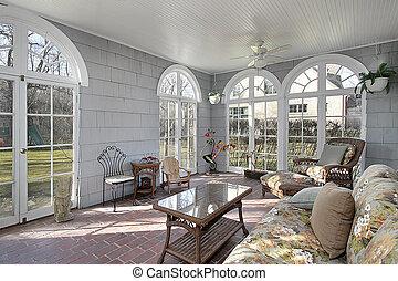 Sunroom with back yard views