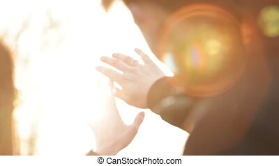 sun's rays pass through the hands