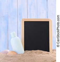 Sunscreen and blackboard. - Jar of sunscreen on the beach...