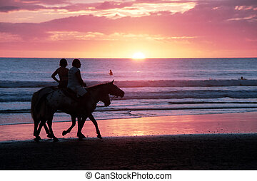 sunset 1 - Horseback riding at sunset on the beach in Costa...
