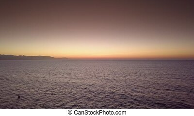 Sunset above calm ocean water - View of colorful sky with...