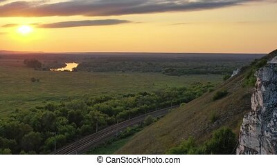 Beautiful sunset above green valley. Aerial view of Divnogorye Museum-Reserve, Voronezh region, Russia, 4k