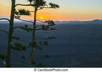 Sunset above mountain landscape.
