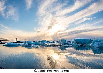 Sunset above the Icebergs on Jokulsarlon Glacier lagoon in Iceland