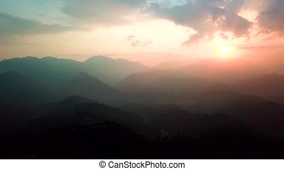 Sunset above valley in the Himalaya mountains, Nepal