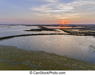 Sunset aerial seascape view of Olhao salt marsh Inlet,...