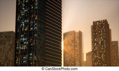 sunset aerial shot of skyscrapers of business centre