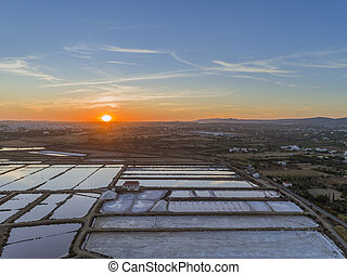 Sunset aerial view, in Ria Formosa wetlands natural park, ...