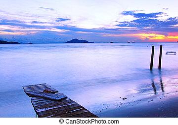 Sunset along a wooden pier