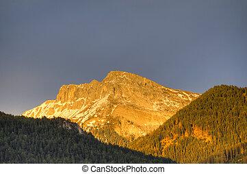Sunset alpenglow on mountains - Sunset glow on mountains in...