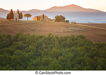 Sunset and a small old chapel in Tuscany, Italy