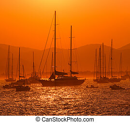 sunset and boats on the sea