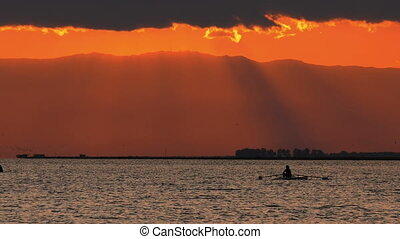 Sunset and Canoe Sport Silhouette