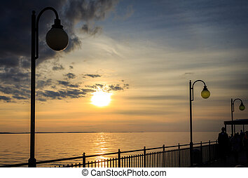 Sunset and lanterns on the pier