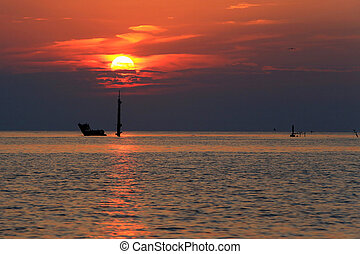 sunset and luxury yacht in the sea,