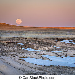 Sunset and moon rise over prairie - Pawnee National ...