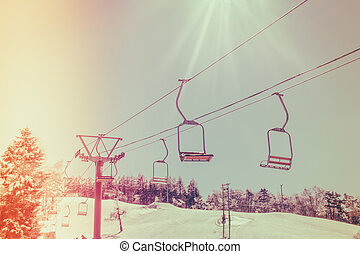 Sunset and Ski lift going over the mountain ( Filtered image...