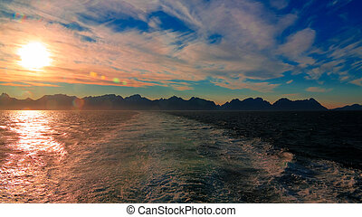 Sunset and sunrise over the sea and Lofoten archipelago from the Moskenes - Bodo ferry, Norway