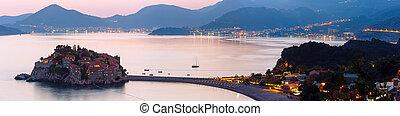 Pink sunset and Sveti Stefan sea islet view from up (Montenegro, 6 kilometres southeast of Budva)