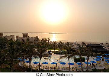 Sunset and the beach of luxury hotel, Ras Al Khaimah, UAE